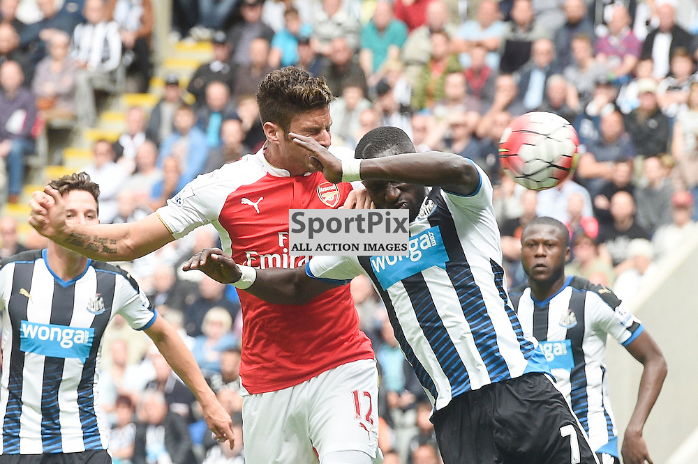 Olivier Giroud (left) and Moussa Sissoko (right) in the Newcastle United v Arsenal Barclays Premier League match at St James' Park Newcastle 09 August 2015<br /> <br /> (c) Greg Macvean / SportPix.org.uk