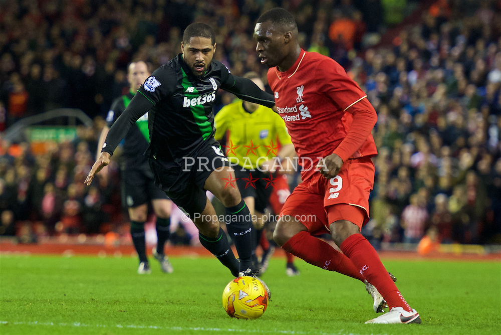 LIVERPOOL, ENGLAND - Monday, January 25, 2016: Liverpool's Christian Benteke in action against Stoke City's Glen Johnson during the Football League Cup Semi-Final 2nd Leg match at Anfield. (Pic by David Rawcliffe/Propaganda)