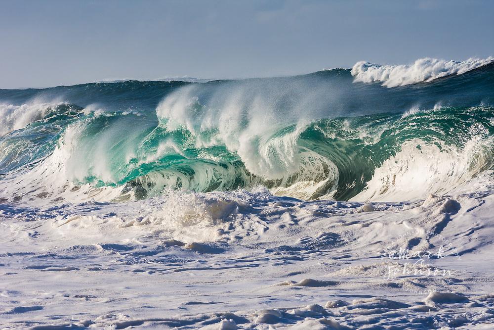Huge powerful shorebreak wave breaking off Kauai, Hawaii