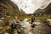 Women do their washing in a stream in Langtang Village, Nepal, on the 28th May 2009<br /> <br /> According to Dorothea Stumm, a glaciologist at the Nepal-based International Centre for Integrated Mountain Development, a massive hanging glacier cracked when an earthquake struck at 11.56am on the 25th April 2015. The ice formed a cloud that gathered snow and rocks and then funnelled down the mountain, burying the village, and creating an enormous pressurised blast. 400 residents of the village and up to 100 trekkers are believed to have been killed.<br /> <br /> PHOTOGRAPH BY AND COPYRIGHT OF SIMON DE TREY-WHITE<br /> <br /> + 91 98103 99809<br /> email: simon@simondetreywhite.com<br /> photographer in delhi