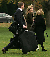 Jenna Bush, (in middle), walks to Marine One with White House staffers, for a ride to Camp David with her parents, President and First Lady Laura Bush on November 20, 2007.  Photograph by Dennis Brack