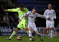Photo: Paul Thomas/Sportsbeat Images.<br />Bolton Wanderers v Aris Salonica. UEFA Cup. 29/11/2007.<br /><br />Danny Guthrie (R) of Bolton battles with Justiniano Garcia.