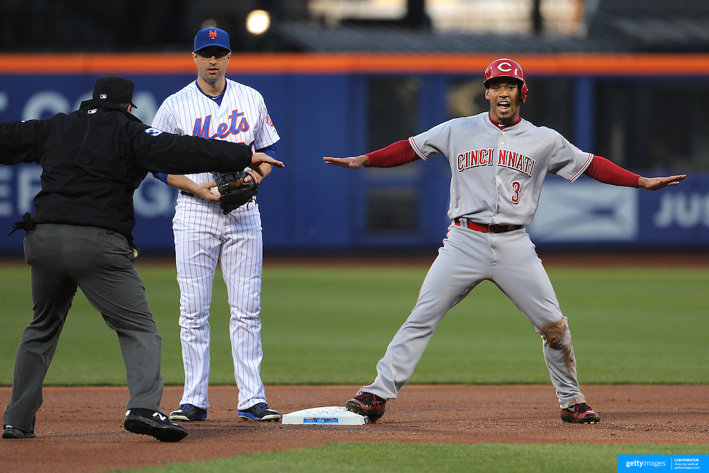NEW YORK, NEW YORK - APRIL 27:  Ivan De Jesus #3 of the Cincinnati Reds is safe at second after a failed run down attempt by the New York Mets during the New York Mets Vs Cincinnati Reds MLB regular season game at Citi Field on April 27, 2016 in New York City. (Photo by Tim Clayton/Corbis via Getty Images)