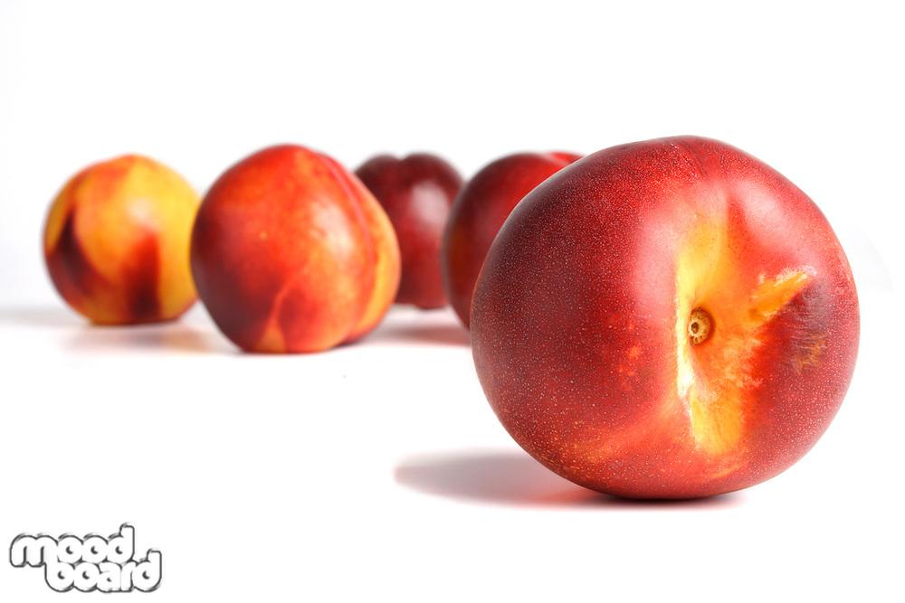 Close-up of nectarine on white background