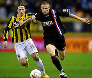 Onderwerp/Subject: Vitesse - Willem II      Eredivisie<br /> Reklame: <br /> Club/Team/Country: Vitesse - Willem II<br /> Seizoen/Season: 2009/2010<br /> FOTO/PHOTO: Vitesse's Alexander BUTTNER (L) in duel with Willem II's Jens JANSE (R) (Photo by PICS UNITED/Aaron van Zandvoort)<br /> <br /> Trefwoorden/Keywords: <br /> #04 $28 &plusmn;1261427875599<br /> Photo- &amp; Copyrights &copy; PICS UNITED<br /> P.O. Box 7164 - 5605 BE  EINDHOVEN (THE NETHERLANDS)<br /> Phone +31 (0)40 296 28 00<br /> Fax +31 (0) 40 248 47 43<br /> http://www.pics-united.com<br /> e-mail : sales@pics-united.com (If you would like to raise any issues regarding any aspects of products / service of PICS UNITED) or<br /> e-mail : sales@pics-united.com <br /> <br /> ATTENTIE:<br /> Publicatie ook bij aanbieding door derden is slechts toegestaan na verkregen toestemming van Pics United.<br /> VOLLEDIGE NAAMSVERMELDING IS VERPLICHT! (&copy; PICS UNITED/Naam Fotograaf, zie veld 4 van de bestandsinfo 'credits')<br /> ATTENTION: <br /> &copy; Pics United. Reproduction/publication of this photo by any parties is only permitted after authorisation is sought and obtained from  PICS UNITED- THE NETHERLANDS