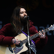 London, UK. 4th March 2018. Biffy Clyro is a rock band preforms at the Women's Day march 2018 marks 100 years since (some) women in the UK were legally allowed to vote. One hundred years on women still marching for equality demand 50/50 women in  Paliament calling for an end sexual harassment, violence and rape.
