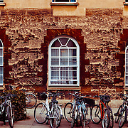 Bikes are everywhere in Oxford. Here are some open sash windows on a warm day in the heart of Oxford, England.