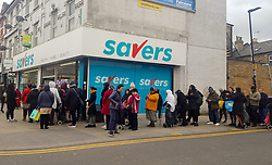 © Licensed to London News Pictures. 13/03/2020. London, UK. Shoppers queue outside Savers in North London for toilet rolls as panic-buying in supermarkets continues amid an increased number of Coronavirus (COVID-19) cases in the UK. Major supermarkets have started to ration certain products after shoppers began to stockpile. 590 cases have been tested positive and ten patients have died from the virus in the UK.. Photo credit: Dinendra Haria/LNP