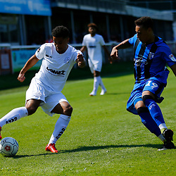 Dover's Jamie Allen on the ball closely shadowed by Gillingham's Aaron Simpson during the pre-season friendly match between Dover Athletic and Gillingham FC at Crabble Stadium, Kent on 21 July 2018. Gillingham ran out 3 to nothing winners. Photo by Matt Bristow.