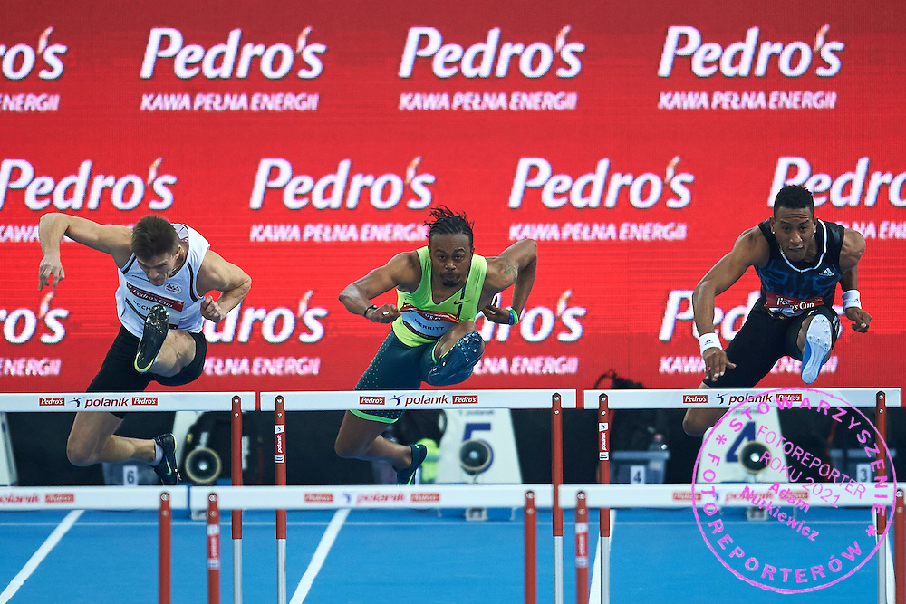 (L) Dominik Bochenek from Poland and (C) Dayron Robles and (R) Orlando Ortega from Cuba compete in men's 60 meters hurdles competition during athletics meeting Pedro's Cup at Atlas Arena in Lodz, Poland.<br /> <br /> Poland, Lodz, February 17, 2015<br /> <br /> Picture also available in RAW (NEF) or TIFF format on special request.<br /> <br /> For editorial use only. Any commercial or promotional use requires permission.<br /> <br /> Adam Nurkiewicz declares that he has no rights to the image of people at the photographs of his authorship.<br /> <br /> Mandatory credit:<br /> Photo by &copy; Adam Nurkiewicz / Mediasport