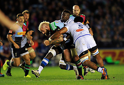 Harlequins captain Joe Marler takes on the Castres defence - Photo mandatory by-line: Patrick Khachfe/JMP - Mobile: 07966 386802 17/10/2014 - SPORT - RUGBY UNION - London - Twickenham Stoop - Harlequins v Castres Olympique - European Rugby Champions Cup