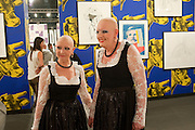 EVA AND ADELE IN FRONT OF WORK BY MIKE KELLEY ON THE TONY SHAFRAZI STAND, , Opening of Miami Art Basel 2011, Miami Beach. 30 November 2011.