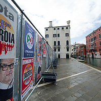 VENICE, ITALY - FEBRUARY 24:  A  general view of Electoral banners seen in Central Venice as the General Election gets underway on February 24, 2013 in Venice, Italy. Italians are heading to the polls today to vote in the elections, as the country remains in the grip of economic problems . Pier Luigi Bersani's centre-left alliance is believed to be a few points ahead of the centre-right bloc led by ex-Prime Minister Silvio Berlusconi.  (Photo by Marco Secchi/Getty Images)