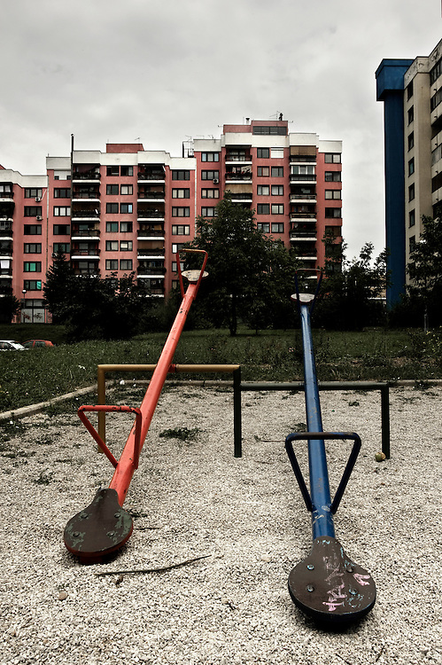 Sarajevo.A view of Mojmilo's playground. Mojmilo, Sarajevo's Olympic village built 1984 close to Dobrinja, a Sarajevo's suburb, for the winter Olympic Games. In 1992 during the Balcan war the village has been almost razed to the ground.  One year after the end of war, in 1996 Barcelona's city through some spanish cooperation projects rebuilt a big part of the village. At time in Mojmilo live approximately 4 thousand people, most of them are young couples with children, teenagers and university students.