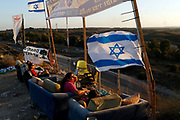 Israelis watch the latest military activity towards Gaza, August 2, 2014. Some Israeli ground forces withdrew from the Gaza Strip on Saturday, two Israeli television stations reported, after the military said it was close to achieving its main war goal of destroying Hamas cross-border tunnels. Asked about the reports, an Israeli military spokesman said she could not comment on troop deployments. Shelling exchanges continued, pushing the Gaza death toll given by Palestinian officials up to 1,669, but in some areas witnesses reported Israeli tanks pulling back toward the border. Israel said Palestinians launched 74 rockets across the border, most of which fell harmlessly wide while seven were shot down by its Iron Dome interceptor, including over Tel Aviv.  REUTERS/Siegfried Modola (ISRAEL - Tags: POLITICS CONFLICT TPX IMAGES OF THE DAY) - GM1EA8306UT01