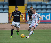 August 5th 2017, Dens Park, Dundee, Scotland; Scottish Premiership; Dundee versus Ross County; Ross County's Michael Gardyne and Dundee's Randy Wolters