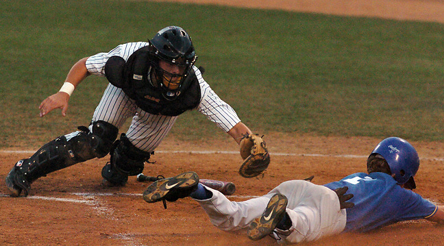 Michael Stenerson / Staff Photographer.Serrano's 1 slides safely into home plate as St. Paul catcher tries to tag him out during the CIF championship game Friday, June 3, 2005 at the University of California Riverside Sports Complex. Serrano won 5-3.