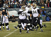 New Orleans Saints defensive end Akiem Hicks (76) and New Orleans Saints defensive end Cameron Jordan (94) celebrate after a third quarter sack on Philadelphia Eagles quarterback Nick Foles (9) during the NFL NFC Wild Card football game against the Philadelphia Eagles on Saturday, Jan. 4, 2014 in Philadelphia. The Saints won the game 26-24. ©Paul Anthony Spinelli