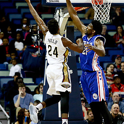 Dec 8, 2016; New Orleans, LA, USA; Philadelphia 76ers center Joel Embiid (21) defends as New Orleans Pelicans guard Buddy Hield (24) shoots during the first quarter of a game at the Smoothie King Center. Mandatory Credit: Derick E. Hingle-USA TODAY Sports