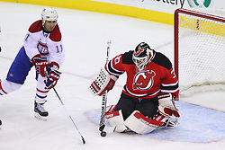 Feb 2; Newark, NJ, USA; New Jersey Devils goalie Martin Brodeur (30) makes a save on Montreal Canadiens center Scott Gomez (11) during the first period at the Prudential Center.