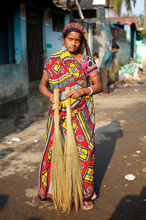 Munni Basfur, age 30, in her neighbourhood of Horijon Palli in Mymensingh.<br /> <br /> Photo: Tom Pietrasik<br /> Mymensingh, Bangladesh<br /> November 20th 2014