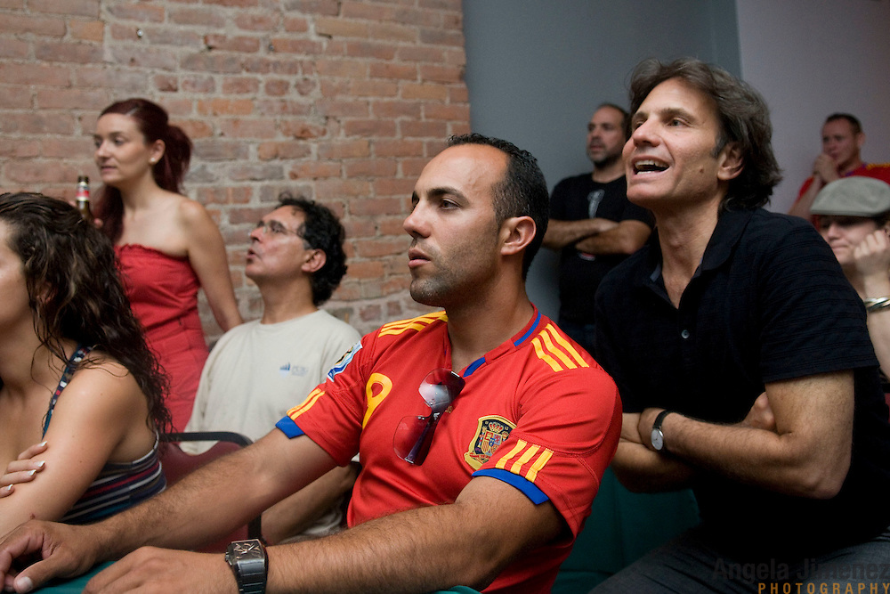 Date: 6/29/10..Spanish fans watch their team's 1-0 World Cup round of 16 victory over Portugal at La Nacional Spanish Benevolent Society in Manhattan on June 29, 2010. ..Photo by Angela Jimenez for Newsweek.com .photographer contact 917-586-0916/angelajime@gmail.com