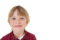 Close-up portrait of a happy school boy over white background