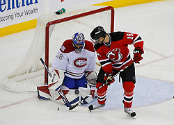 Jan 2, 2009; Newark, NJ, USA; Montreal Canadiens goalie Marc Denis (38) makes a save while New Jersey Devils center Travis Zajac (19) looks for the rebound during the third period at the Prudential Center.  The Devils defeated the Canadiens 4-1.