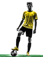 one Brazilian soccer football player young man standing in silhouette studio on white background