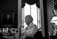 WASHINGTON, DC - MARCH 13: During a quiet moment at his desk, Vice President Joe Biden meets with staff in his office at the White House on Wednesday, March 13, 2013. (Photo by Melina Mara/The Washington Post)