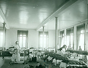 Children's ward in  a hospital where nuns act as nurses. France circa 1905
