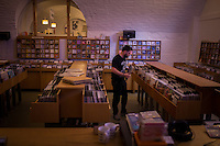 Glasgow, Scotland - JULY 11, 2014: Meticulously filing records at Monorail Music, an independent record store revered for it's vast vinyl collection, which ranges from classics to wild rarities. Founded by a local musician, Monorail is a vital part of the Glasgow music scene and has hosted in-store gigs for the likes of local legends such as Belle and Sebastian. CREDIT: Chris Carmichael for The New York Times