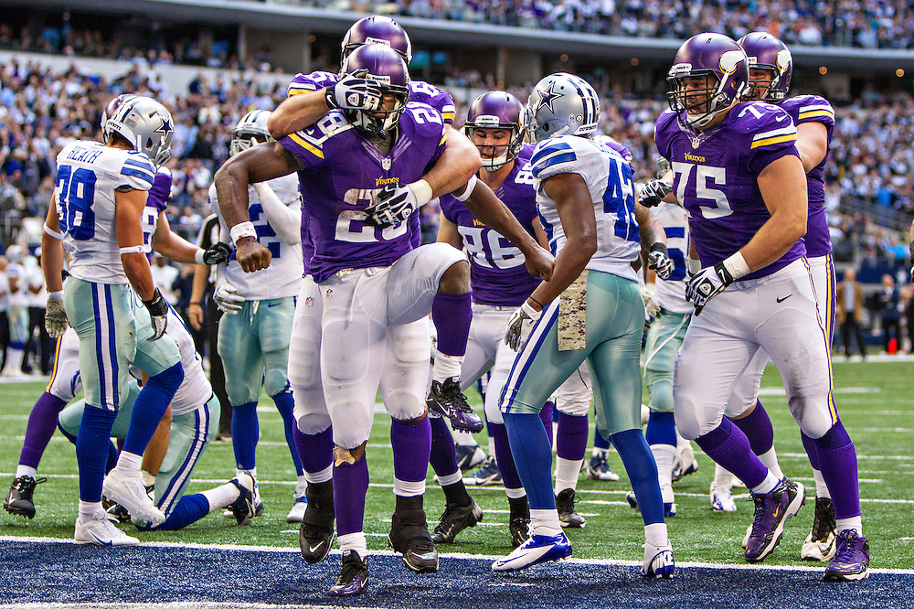 ARLINGTON, TX - NOVEMBER 3:  Adrian Peterson #28 is congratulated by John Sullivan #65 of the Minnesota Vikings after scoring a touchdown against the Dallas Cowboys at AT&T Stadium on November 3, 2013 in Arlington, Texas.  The Cowboys defeated the Vikings 27-23.  (Photo by Wesley Hitt/Getty Images) *** Local Caption *** Adrian Peterson; John Sullivan