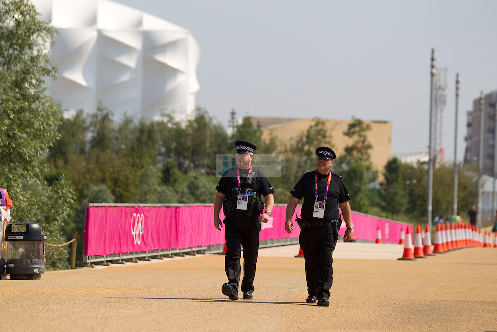 Police officers patrol near the Olympic Stadium on July 26, 2012 in London, England. (Jed Jacobsohn/for The New York Times)....