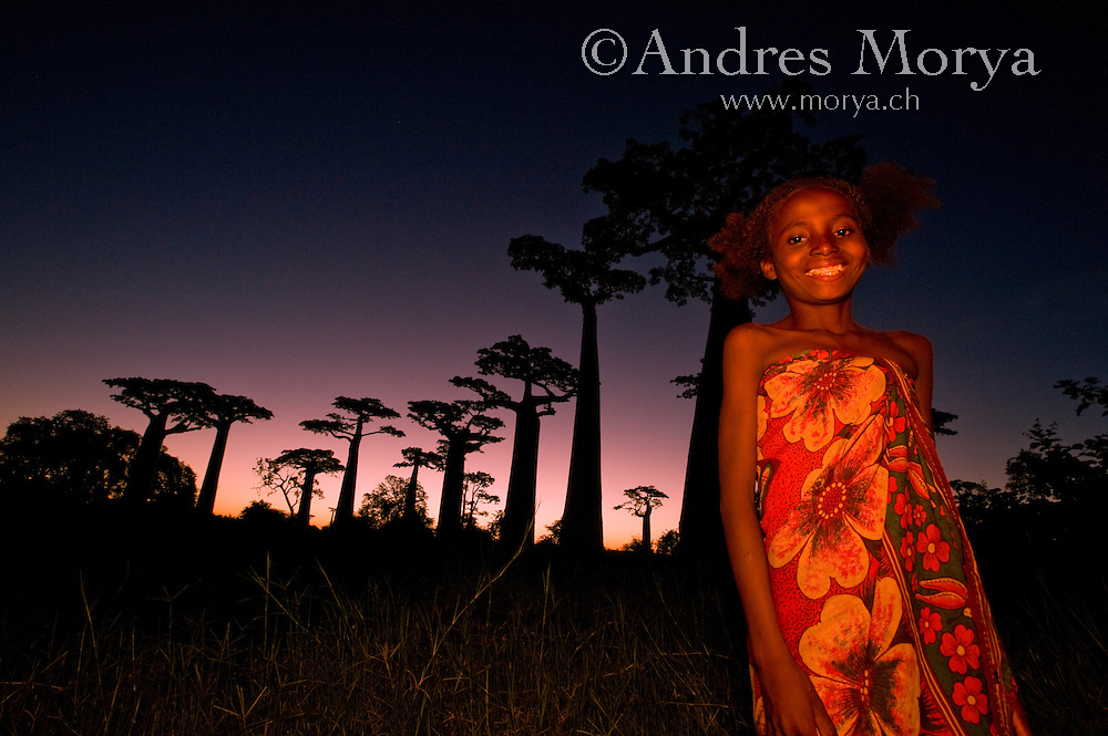 Malagasy Children and Baobabs Forest at sunset, Morondava, Madagascar Image by Andres Morya