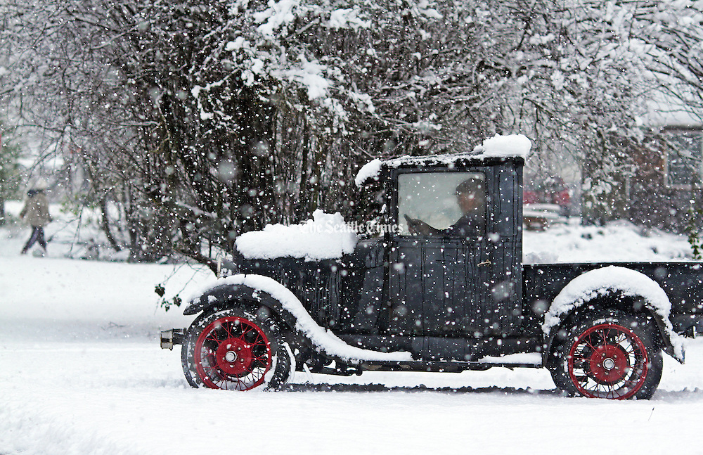 A motorist in a 1929 Model A drives to the post office through half a foot of snow that fell in Darrington. <br />