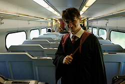 Harry Potter on board of the Hogwarts Express from Center City. The train, carrying other Potter characters, together with hundreds of Potter fans arrived with a fifeteen minute delay. (Bastiaan Slabbers/for PhillyVoice)