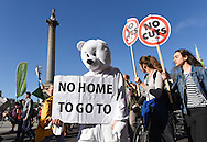 A demonstrator dressed as a Polar Bear gets his message across as the rally passes Nelson's Column in Trafalgar Square during the Time To Act, National Climate March organised by Campaign Against Climate Change in London, England on March 7, 2015