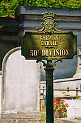 Street sign and graves at Père Lachaise Cemetery, Paris, France