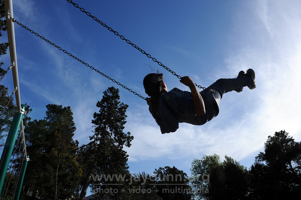 A child enjoys newly installed swings on March 26th, 2016 at the Acosta Plaza Recreation Area, soon to be formally opened in east Salinas, CA.