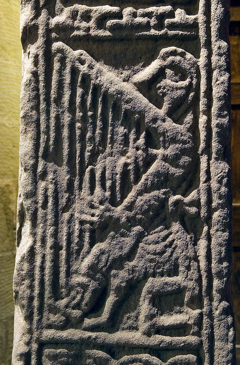 Side panel, 9th C. Dupplin Pictish Cross. Old Testament David playing harp. St. Serfs Church in the village of Dunning, Scotland