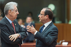 Francois Hollande, France's president, right, speaks with Mario Monti, Italy's prime minister, during the EU Summit, at the European Council headquarters in Brussels, Belgium on Friday, Oct. 19, 2012. (Photo © Jock Fistick)