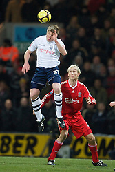 PRESTON, ENGLAND - Saturday, January 3, 2009: Liverpool's Sami Hyypia and Preston North End's Neil Mellor during the FA Cup 3rd Round match at Deepdale. (Photo by David Rawcliffe/Propaganda)