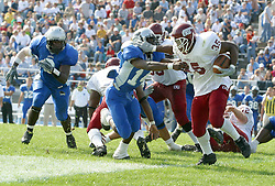 12 October 2002: Terry Ennis offers a stiff arm that's more of a facemask.  Eastern Illinois University Panthers host and defeat the Colonels of Eastern Kentucky during EIU's Homecoming at Charleston Illinois.