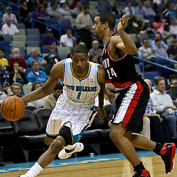March 30, 2011; New Orleans, LA, USA; New Orleans Hornets small forward Trevor Ariza (1) drives past Portland Trail Blazers point guard Andre Miller (24) during the first half at the New Orleans Arena.    Mandatory Credit: Derick E. Hingle