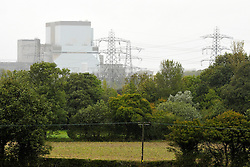 © Licensed to London News Pictures. 21/10/2013.  Hinkley Point, Somerset, UK.  Hinkley B, Hinkley Point Nuclear Power Station, which currently comprises the decommissioned Hinkley A station with Magnox Reactors (blue square buildings) and Hinkley B station (grey building complex, a more modern AGR design). The UK Government today announced the go-ahead for a new nuclear power station at Hinkley Point C in Somerset, to be built by a consortium with French firm EDF Energy and Chinese investment for the first time in UK nuclear power generation.21October 2013.<br /> Photo credit : Simon Chapman/LNP