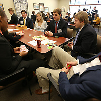 Students sit in a holding room and play bopard games as they wait their turn for the role playing competetion at Wednesday's DECA conference held at the ICC Belden campus.