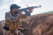 KURDISTAN, NORTHERN IRAQ, Dokuk.<br /> Qalubna Ma'Kum Feature:<br /> Qalubna Ma'kum (meaning &quot;Our hearts are With You&quot;) are a group of foreign volunteer fighters who have joined up with the Peshmerga in Kurdistan to help with the battle against Daesh, also known as ISIS. <br /> <br /> Pictured: French volunteer and co-founder of Qalubna Ma'kum Francis Cuvelier (back) trains a new volunteer , also from France (front).