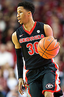 FAYETTEVILLE, AR - MARCH 4:  J.J. Frazier #30 of the Georgia Bulldogs dribbles the ball down the court during a game against the Arkansas Razorbacks at Bud Walton Arena on March, 2017 in Fayetteville, Arkansas.  The Razorbacks defeated the Bulldogs 85-67.  (Photo by Wesley Hitt/Getty Images) *** Local Caption *** J.J. Frazier