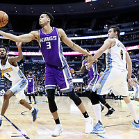 06 March 2017: Sacramento Kings forward Skal Labissiere (3) reaches for the ball past Denver Nuggets guard Will Barton (5) and Denver Nuggets forward Danilo Gallinari (8) during the Denver Nuggets 108-96 victory over the Sacramento Kings, at the Pepsi Center, Denver, Colorado, USA.